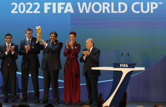 Qatar's Emir Sheikh Hamad bin Khalifa al-Thani (C) raises the World Cup trophy as he stands with his wife Sheikha Moza, their son Sheikh Mohammed, chairman of the Qatar 2022 bid committee, (L) and FIFA president Joseph Blatter (R) after Qatar was chosen to host the 2022 World Cup at the FIFA headquarters in Zurich on December 2, 2010. Qatar became the first Arab, Middle Eastern or Muslim country to be awarded the right to stage football's World Cup. AFP PHOTO/KARIM JAAFAR (Photo credit should read KARIM JAAFAR/AFP/Getty Images)