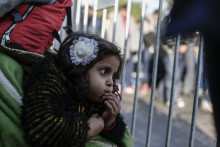 Asma, 3, a refugee from Syria, waits with her family at a registration centre for migrants and refugees in Preševo, in southern Serbia, on October 5, 2015. Oxfam will be distributing materials to help those who have reached Serbia to cope with the coming winter.