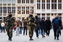 Belgian Army soldiers and police officers patrol in the picturesque Grand Place in the center of Brussels on Friday, Nov. 20, 2015.  Salah Abdeslam, a French national who lived in Molenbeek, Belgium, is currently the subject of an international manhunt after the Paris attacks. Security has been stepped up in parts of Belgium as a precaution. (ANSA/AP Photo/Geert Vanden Wijngaert)